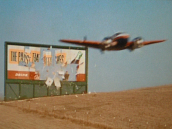 here is a movie of a beech 18 flying through a billboard 414 kb